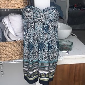 Patterned dress with structured top.